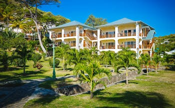 Bequia Beach hotel exterior, buildings, gardens, lawn, palm trees