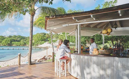 Cotton House St Vincent and the Grenadines beach bar at side of the beach
