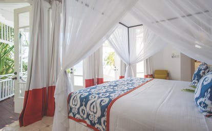Cotton House St Vincent and the Grenadines bedroom canopied king size bed doors opening to balcony