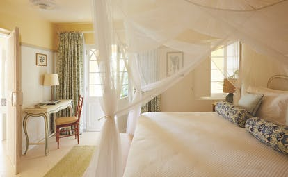 Cotton House St Vincent and the Grenadines bedroom canopied bed dressing table