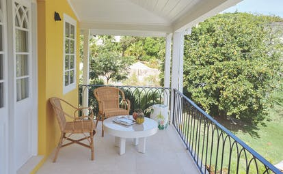 Cotton House St Vincent and the Grenadines villa balcony outdoor seating area overlooking lawns#