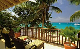 Palm Island St Vincent and the Grenadines island loft balcony sun loungers view of ocean boats on water
