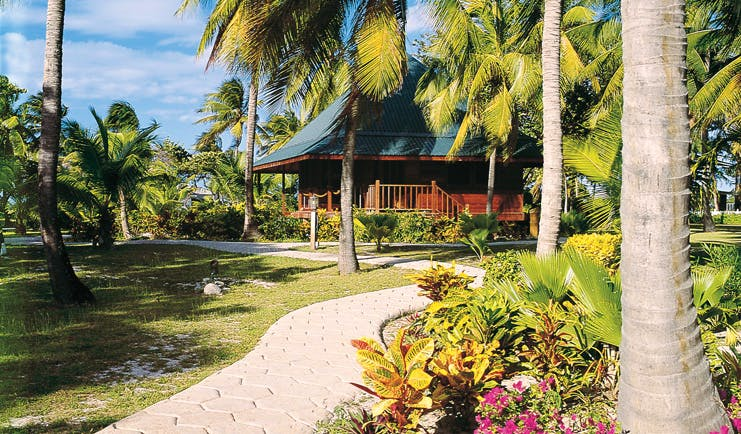 Palm Island St Vincent and the Grenadines loft exterior path through lawns and gardens palm trees