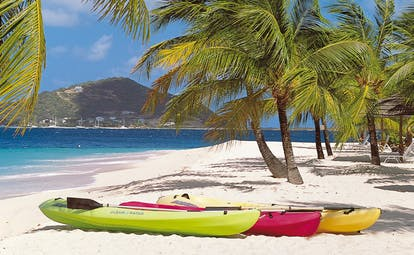 Palm Island St Vincent and the Grenadines kayaks on the beach ocean palm trees