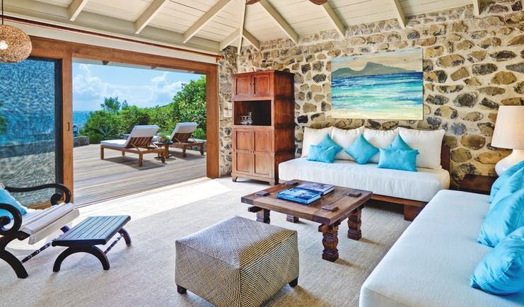 Petit St Vincent beach villa living area indoor seating decking lounger ocean views