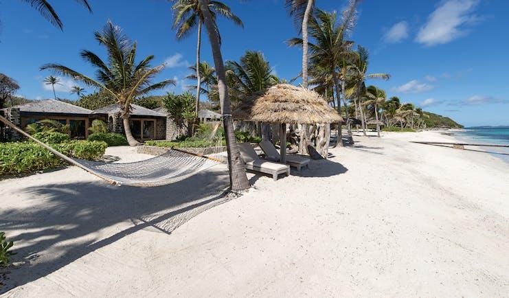 Petit St Vincent beach hammock palm trees