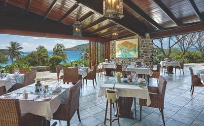 Petit St Vincent restaurant indoor dining views of the ocean