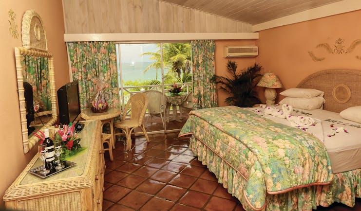Coco Reef Tobago bedroom rattan bedroom furniture doors leading to balcony