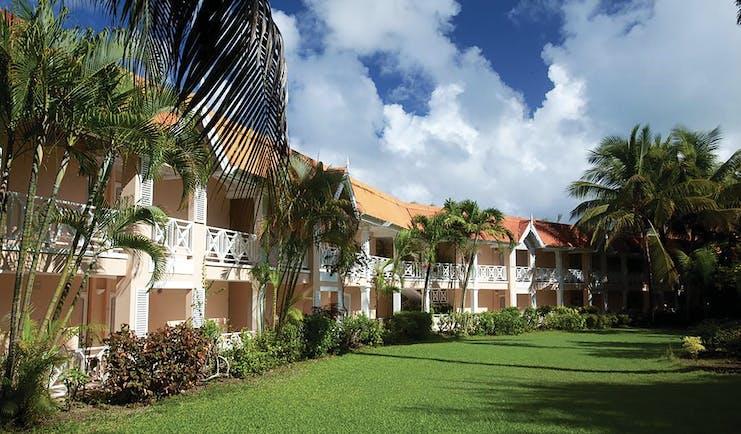 Coco Reef Tobago hotel exterior lawn trees building