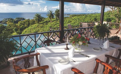 The Villas at Stonehaven Tobago villa veranda dining views of infinity pool and ocean