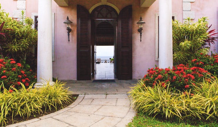 The Villas at Stonehaven Tobago villa entrance pink building shrubbery