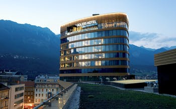 Adlers Hotel Austria exterior view of building with mountains in the background