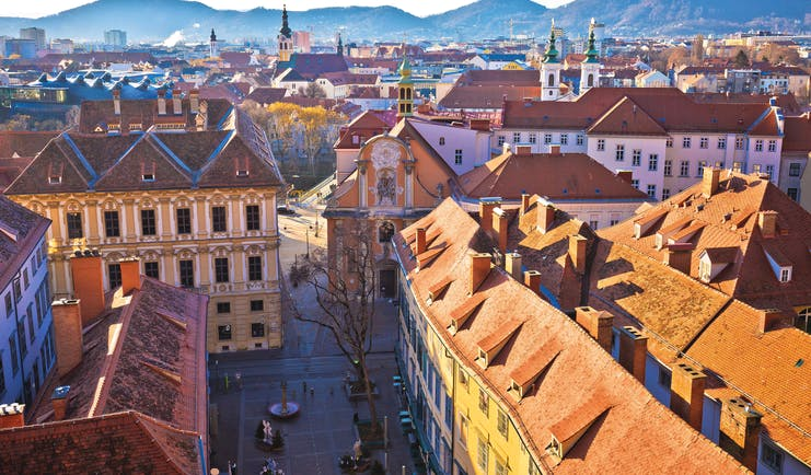 Reddish brown roofs of buildings in the city of Graz Austria