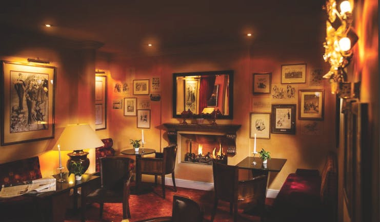 Hotel Bristol Salzburg bar with dim lighting, paintings on the walls and seating areas