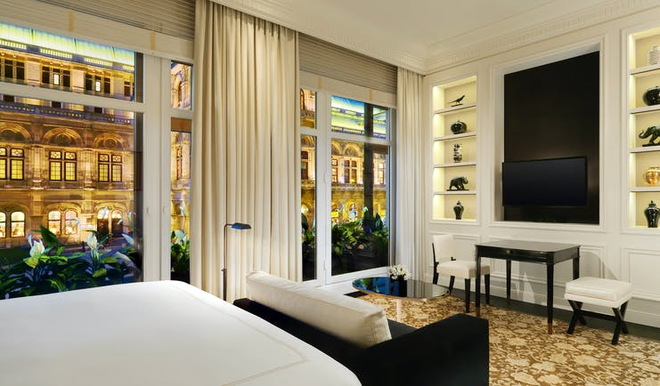 Hotel Bristol Vienna grand deluxe bedroom sofa book case  large windows with city view