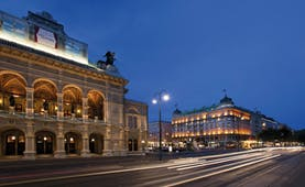 Hotel Bristol Vienna state opera house the hotel and a city street at night time