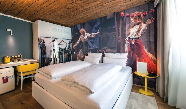Hotel Goldgasse double bed within a modern stylised room