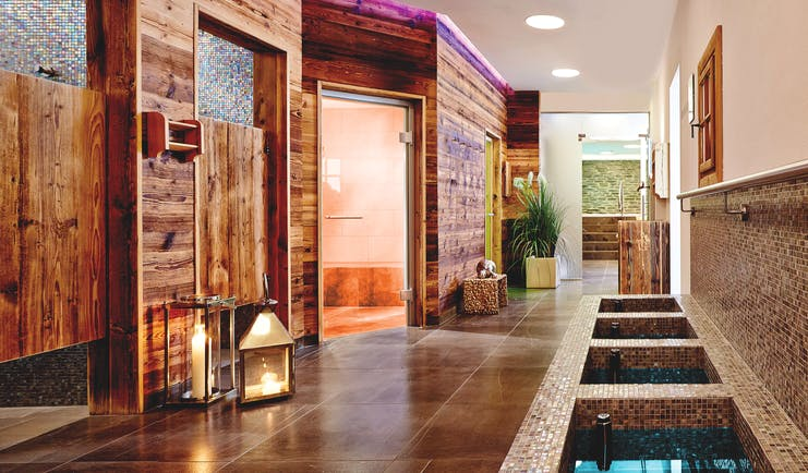 Spa walkway with sauna and steam room in sight