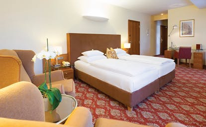 Hotel Kaiserhof Vienna junior suite bedroom red carpet armchair and desk
