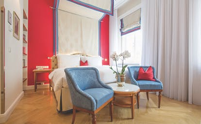 Hotel Kaiserhof Vienna superior blue bedroom canopy bed two blue armchairs