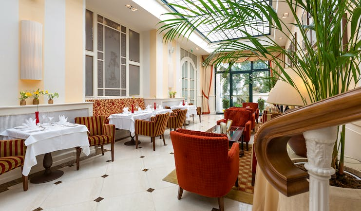 Hotel Kaiserhof Vienna winter garden conservatory room plants and comfortable seating