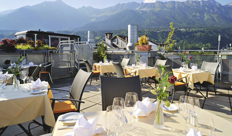 Hotel Schwarzer Adler dining terrace, outdoor dining area with mountain views