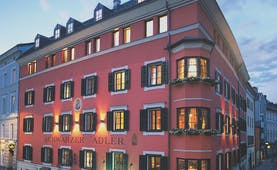 Hotel Schwarzer Adler exterior, grand red building on sreet corner