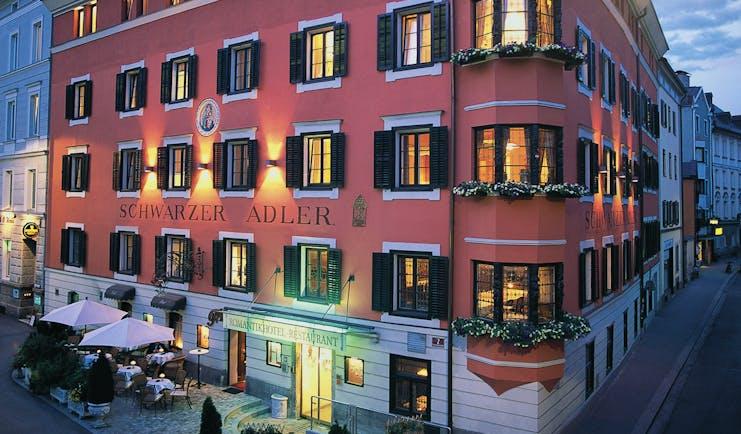 Hotel Schwarzer Adler exterior, grand red building on sreet corner