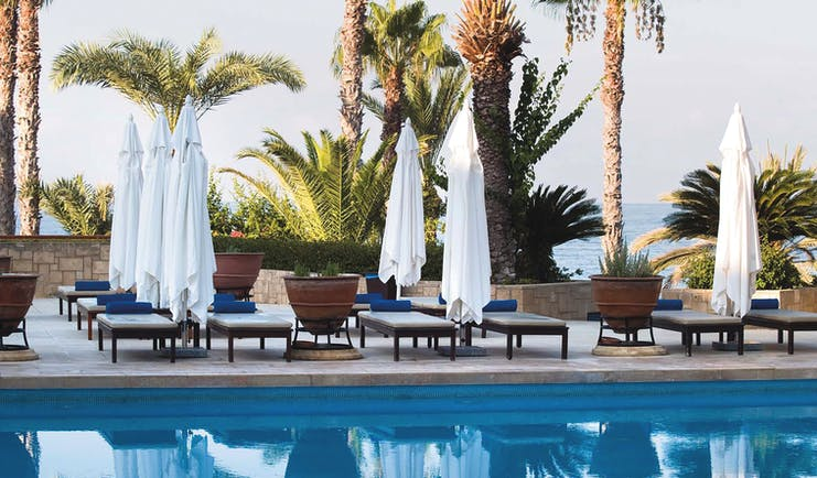 Annabelle Hotel Cyprus outdoor swimming pool with loungers and umbrellas