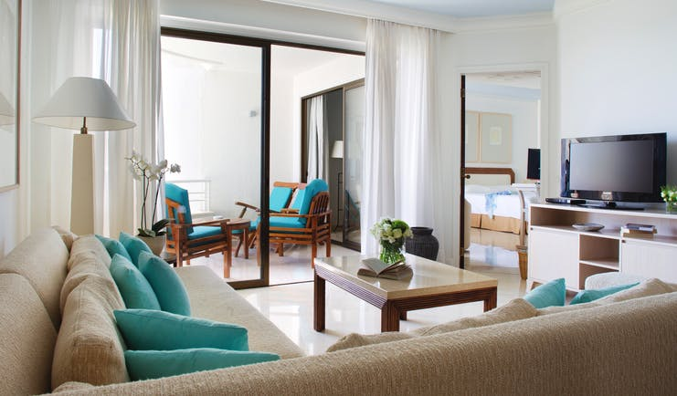 Annabelle Hotel Cyprus superior suite sitting room sofas and balcony with armchairs