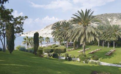 Columbia Beach Resort Cyprus gardens grounds sun loungers palm trees beach view