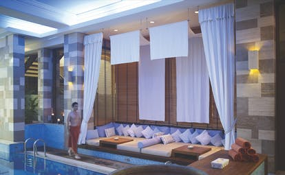 Columbia Beach Resort Cyprus indoor spa pool with sofa seating area and bowl of flowers