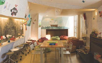Columbia Beach Resort Cyprus kids club room with mural of a ship a table and chairs and beanbags