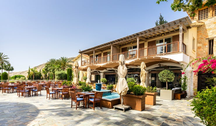 Columbia Beach Resort Cyprus outdoor dining terrace in front of a building with balconies