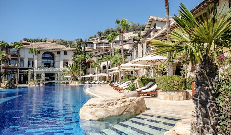 Columbia Beach Resort Cyprus outdoor pool with bridge and sun loungers