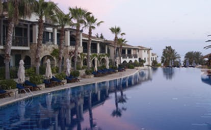 Columbia Beach Resort Cyprus outdoor pool at twilight with loungers and umbrellas