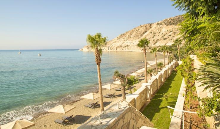Columbia Beach Resort Cyprus Pissouri beach sun loungers and umbrellas