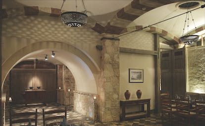 Columbia Beach Resort Cyprus restaurant Taverna dining area with stone tiled floors walls and archways