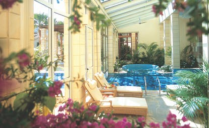Columbia Beach Resort Cyprus spa pool indoor with large windows and loungers