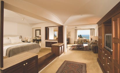 Columbia Beach Resort Cyprus suite with bedroom and sitting area and balcony with sea view