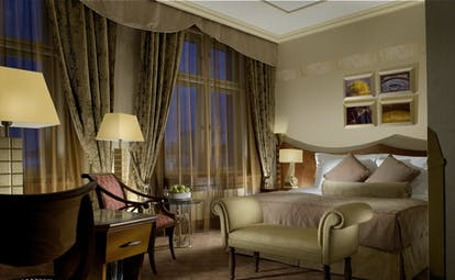 Art Deco Imperial executive room, double bed, chair, draped windows, sumptuous modern decor
