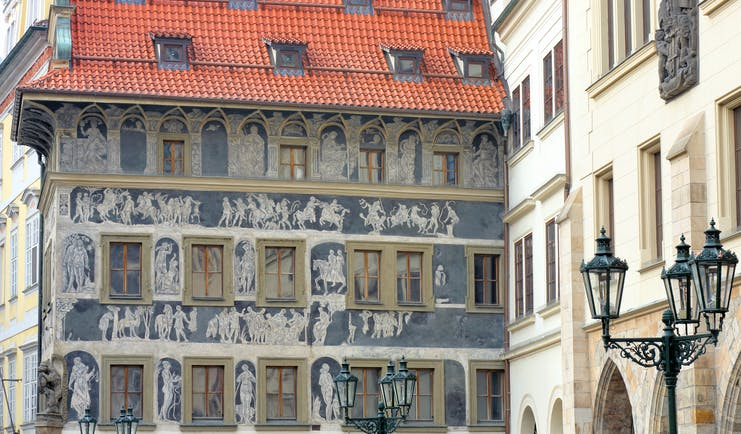 Prague old building with murals