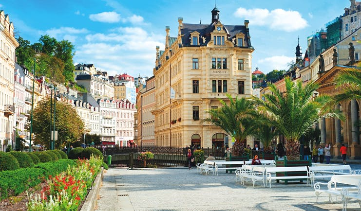 Square with tall, elegant buildings and trees in Karlovy Vary