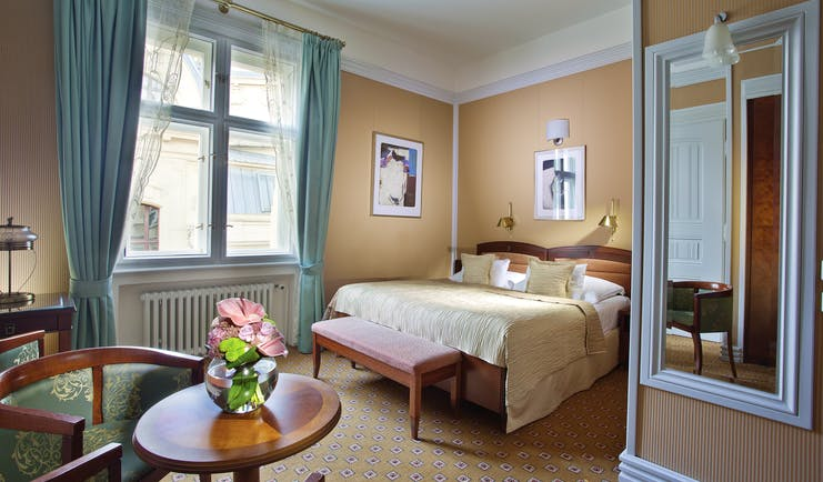 Hotel Paris Prague deluxe bedroom white mirror round table flowers and large window