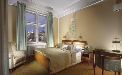 Hotel Paris Prague executive bedroom  armchair desk window with view of old town