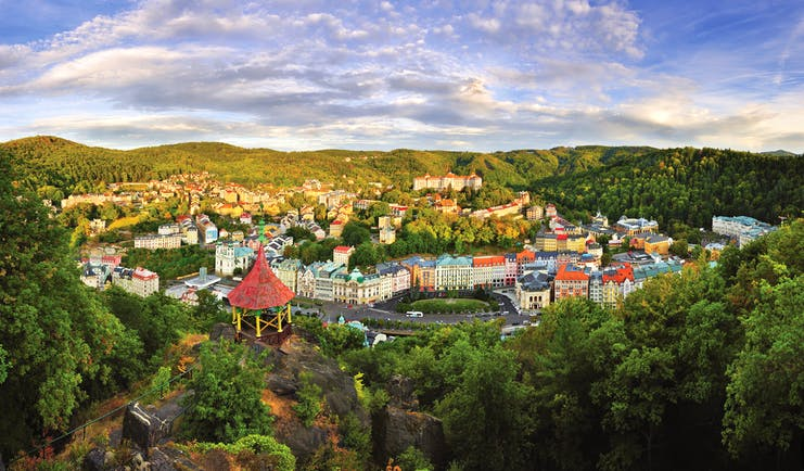 Hotel Quisisana Palace Karlovy Vary aerial view of a small town surrounded by wooded hills