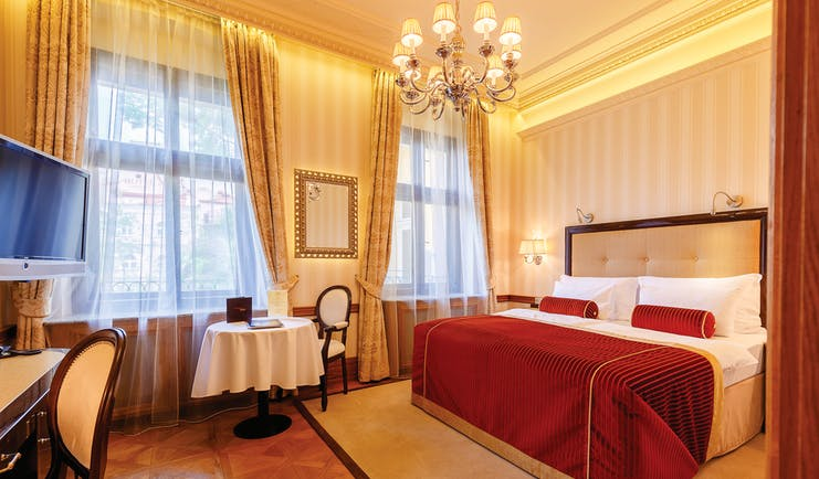 Hotel Quisisana Palace Karlovy Vary deluxe bedroom chandelier table and chairs and desk