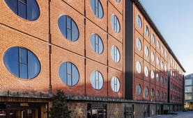 Hotel Ottilia exterior, brick building with round windows, industrial in style