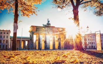 Autumn sunlight shining through the Brandenburg arched gate in Berlin
