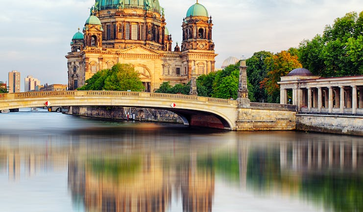 Berlin cathedral reflected in water of river spree